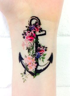 Love how the flowers are done on this tattoo. My next tattoo will have minimal black outline