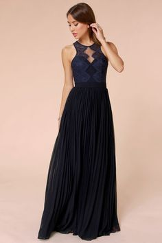 """Only the luckiest of girls will get to wear the Bariano Luciana Navy Blue Lace Maxi Dress with its dazzling details and flattering fit! A structured sweetheart bodice (with padded cups) is topped by a layer of lovely sheer lace that outlines a sleeveless bodice with back cutout, plus four covered buttons for fastening. The banded waist introduces a pleated maxi skirt that makes stunning circles on the dance floor! Hidden back zipper/hook clasp. Lined in navy blue satin. Model is 5'8"""" and is…"""