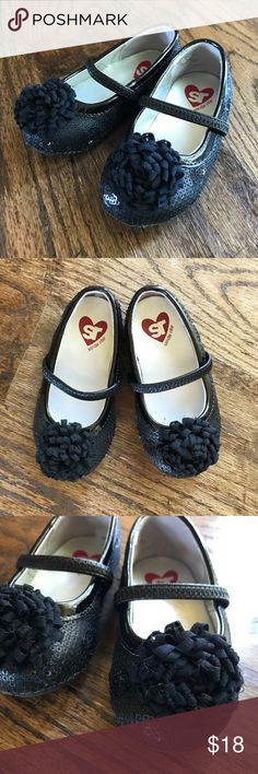 Stride Rite Kenleigh toddler girls size 5.5. Stride Rite toddler girls black sequin Mary Jane shoes with pom on toe. Super cute and girly for your little one!   These are in GUC.  **Bundle and save on other children's clothes in my closet! Stride Rite Shoes