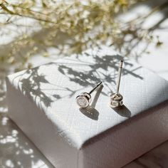 Excited to share this item from my #etsy shop: Dainty Cubic zirconia bezel stud earrings Sterling silver, dot stud earrings, Tragus stud, cartilage stud, tiny 4mm CZ silver earrings Dainty Earrings, Dainty Jewelry, Sterling Silver Earrings Studs, Stud Earrings, Cartilage Stud, Jewelry Polishing Cloth, Cufflinks, Delicate, Dots