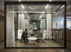 White type/graphics on glass. from fiftythree New York Office Design