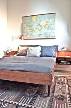 vintage bedroom, teak bed, industrial lamps, world map, mid century, native rug