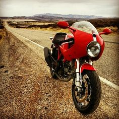Ran out of gas on Idaho Hwy 20, near Mountain Home Reservoir, ID. I had a good walk pushing my bike until a nice family stopped and gave me some gas. Ducati Sport Classic 1000S, SC1000S (at Mountain Home, ID)