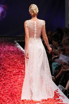 "Love the dress, but the ""Fluff"" down the middle of back brings it down a bit. Ron.  Claire Pettibone, Fall 2014"