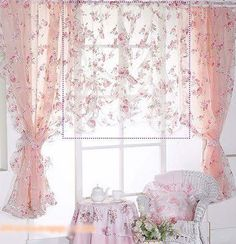 Pretty sheer pink curtains with roses in a victorian shabby chic cottage sitting room. Beautiful window scape.