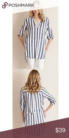 NEW Striped Tunic Navy blue and white striped tunic features 3/4-sleeves with button tab and collarless v neck styling. Made from a 100% rayon woven fabric. Very cute. Entro Tops Tunics