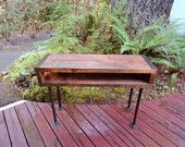 5 ft Industrial Salvaged Barnwood Desk with pipe legs. $485.00, via Etsy.