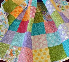 Ready to Ship, Colorful Baby Toddler Quilt, Whites, Pinks, Purples, Greens, Orange, Teals,and Yellow. $150.00, via Etsy.