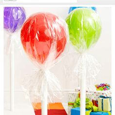 Lollipop balloons...why didn't I think of THIS! Line the walkway leading to the front door!