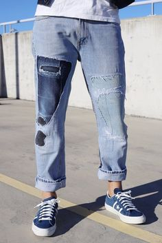 Thispair of authentic Levi's 501 jeans havebeen uniquely distressed, destroyed and repaired in Australia. Featuring two prominent of indigo on each leg, sashi