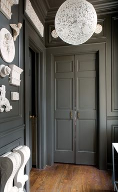 Dawn Trimble's Sir John Soane-inspired passageway.  shape, hardware and color