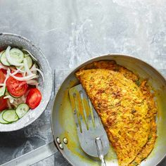 Masala Omelette Recipe Check out our easy spiced omelette recipe with fiery ginger and punchy chilli, served with a crisp tomato and cucumber salad Healthy Egg Recipes, Egg Recipes For Breakfast, Vegetarian Breakfast, Low Calorie Recipes, Brunch Recipes, Vegetarian Recipes, Easy Egg Recipes, Breakfast Time, Omelette Recipe