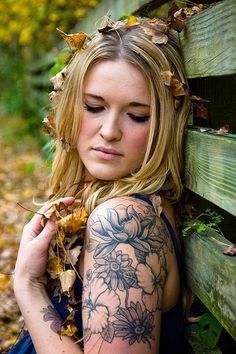 Flowers...hmm I'm wondering if I can cover or add on to my shoulder tattoo like this.