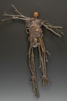 Brenna Busse mixed media figures dolls metal tree sticks