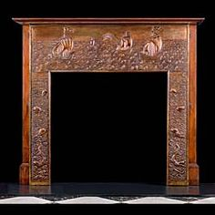 Grand Repousse Copper antique Fireplace Surround. -- Attributed to John Pearson,  Master Coppersmith and founder member of the Guild of Handicrafts.  This elaborately decorated fireplace on its mahogany ground follows a maritime theme depicting mythical sea creatures in the deep and Galleons riding the waves in rolling seas all typical of Pearson's work.  English circa 1900.
