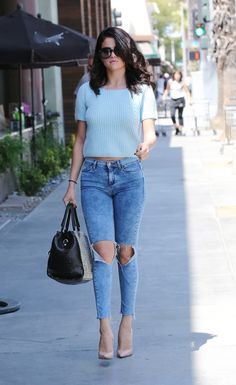 Selena Gomez looks street stylish while shopping at a mall in Studio City, California. June 16, 2014.