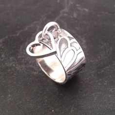Sterling silver embossed band with heart charm hallmarked in Edinburgh