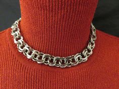 Don't be linked to boring when you can be chained with this simple beauty.  Add pizzazz to any outfit with an Ernest Steiner choker necklace.