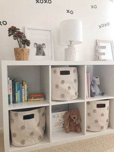 My nursery styling and organization project was made simple with this white IKEA Kallax Shelf. We used it as a way to cleanly store baby toys, books and other must-haves. The pom pom baskets make for great hidden storage.