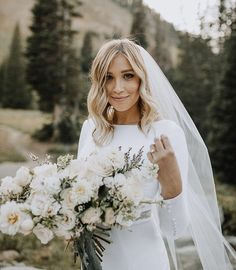 modest wedding dress with long sleeves from alta moda. -- (modest bridal gown) photo by Ashley Rae #weddingdress