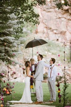 rainy day ceremony, photo by Our Love is Loud http://ruffledblog.com/river-bend-colorado-wedding #weddingceremony #ceremonies #wedding