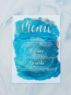Blue water color wedding menu with gold calligraphy