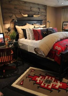 bedroom style. love the wooden wall with the sleigh bed and red accents