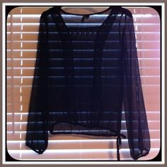 ♦️by Eye Candy ➰ Black, Sheer, Long Sleeve Top ♦️ Black, sheer, long sleeve top with lace detailing around the neck and down both sides on the front, as well as a side draw string tie. EXCELLENT CONDITION Sz Medium Eye Candy Tops