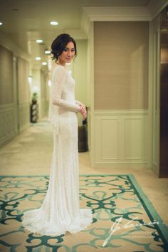 d631044cb32a Long sleeve fitted wedding gown from Bangkok-based Calista Boutique.