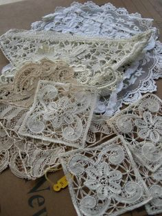 Lovely collection of antique French lace appliques - several handmade lace