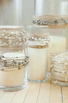 Over 15 electric wax candles that sit inside a pearl wired/twine wrapped clear vase. Candles are all different sizes and looked very pretty at our beach wedding. 100$ for all of them or individually priced