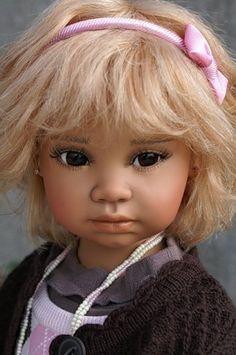 Porcelain doll by Angela Sutter