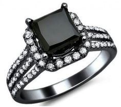 Love the cut but all the white diamonds around it are a bit much. However, Amazingly beautiful!