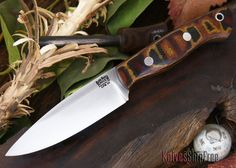 The Bark River Knives: Mini-Aurora - CPM 3V - Snakeskin Burgundy Canvas Micarta IN STOCK at Knives Ship Free. All Bark River Knives are backed by a strict no-questions-asked lifetime warranty.