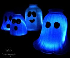 Outdated glass light shades (frosted or white) are a staple at thrift stores and home salvage shops. Here's a fun, EASY way to repurpose them for Halloween!  Cl…