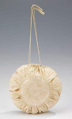 Reticule Date: first quarter 19th century Culture: American Medium: cotton Dimensions: 8 in. (20.3 cm) Credit Line: Brooklyn Museum Costume Collection at The Metropolitan Museum of Art, Gift of the Brooklyn Museum, 2009; Gift of Mrs. James H. Post, 1952 Accession Number: 2009.300.2382