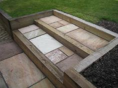 Multi-Level Gardens with Stone | Sleeper and paved steps