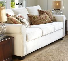 """Buchanan Sofa by Pottery Barn, for the living room, made in the USA, 87"""" wide x 38.5"""" deep x 36.5"""" high, frame is made of kiln dried hardwood, has double-padded seat cushions, a thickly cushioned back and arms, springs made of heavy-gauge steel, so it will be comfortable but not so nice that the client will sink into the couch and never be able to climb back out"""