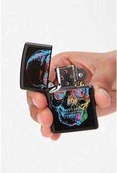 Fun 80's style skull on black Zippo Lighter.