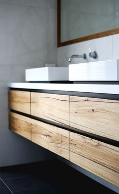 Stone and timber bathroom vanity. The Tathra features a pure white caesarstone top and recycled Messmate timber. Each vanity is designed and made to order by our talented team of furniture makers. The internal structures and drawer boxes are also made from solid timber for that extra touch of longevity.