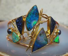 Boulder opal bracelet with druzy quartz, pearl, in 22k and 18k gold.  Jennifer Kalled