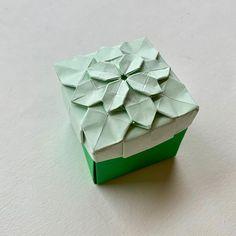Hydrangea box ( hydrangea tessellation is designed by Tomoko Fuse) origami hydrangea giftbox flower tessellation papercraft paperart Origami Studio, Origami Gift Box, Gift Boxes, Hydrangea, How Are You Feeling, Pottery, London, Make It Yourself, Flowers