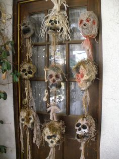 Inspiration.....these are Voodoo sticks made from great stuff :skulls, bamboo sticks from Dollar Store, paint, dyed cheesecloth, real bones, ... #indoorhalloweendecorations