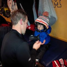 Howie prepping his 2-year-old son, James, for the family skate at the Big House (12/31/13)