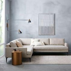 L Shaped sofa design reference. Legs are cast metal and solid.