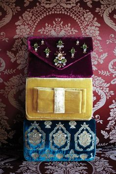 how to wear velvet: carry a clutch