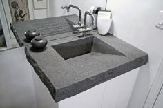 Master baths, powder rooms and the kids' bathroom have all become home to the beauty, innovation and imagination of concrete countertops. Concrete countertops is shaped to include the sink.