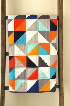 Modern geometric quilt by CraftyBlossom - great colors!