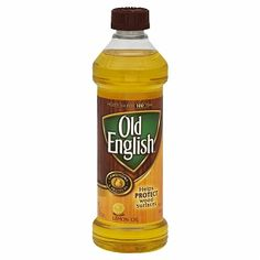 Old English Lemon Oil.This works great on old shower glass doors to remove hard water spots.You dont need a lot.dab on paper towel then rub over entire glass.Not only does it remove water spots it also prevents them.