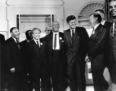 American president John F. Kennedy in the White House with leaders of the civil rights March on Washington (left to right) Whitney Young, Dr Martin Luther King (1929 - 1968), Rabbi Joachim Prinz, A. Philip Randolph, President Kennedy, Walter Reuther (1907 - 1970) and Roy Wilkins. Behind Reuther is Vice-President Lyndon Johnson. (Three Lions/Getty Images)